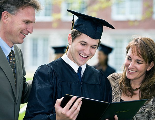 Proud parents with student look at diploma