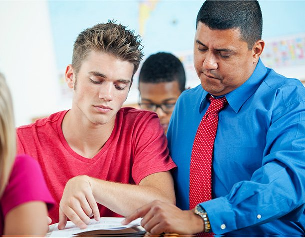Student and professional tutor engage in classroom setting