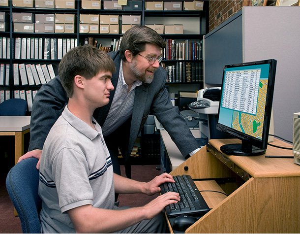 SAT private tutor and student work on a computer together